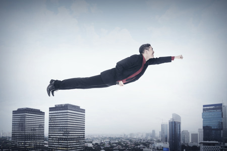 man flying: Business man flying. Job promotion concept