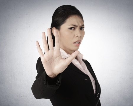 Business woman say no, with grunge wall background Stock Photo