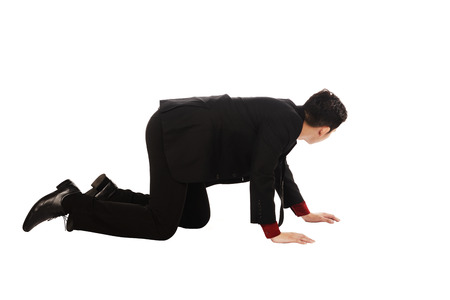 Asian business man crouching isolated over white background