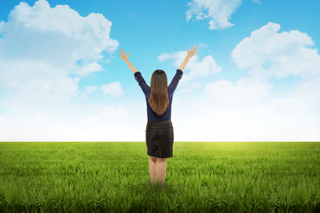 indonesian woman: Business woman feeling happy on the meadow at summer time