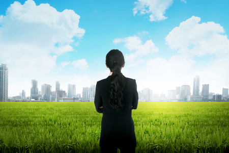 backview: Backview of asian business woman on the meadow Stock Photo