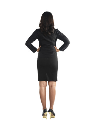 backview: Asian business woman standing backview isolated over white background Stock Photo