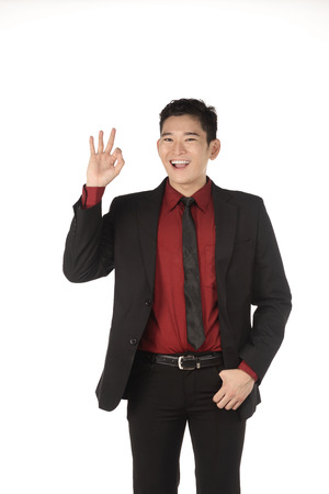 give hand: Asian business man give hand gesture OK isolated over white background