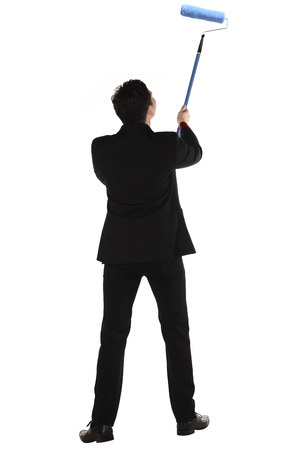 Man painting something with roller brush isolated over white background