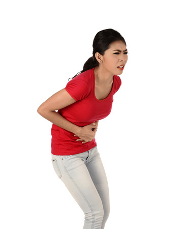 fatigued: Asian woman have stomach ache isolated over white background