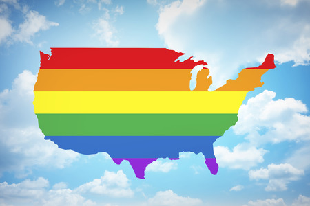 gay marriage: Rainbow flag on United states of america with blue sky background. Gay marriage is legal nationwide