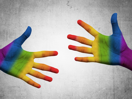Two hand with gay flag color. Gay pride conceptual Stock Photo