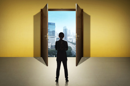 path ways: Business woman going to the open door. Career path conceptual Stock Photo