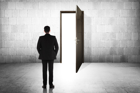Business man going to the open door. Career path conceptual Stock Photo