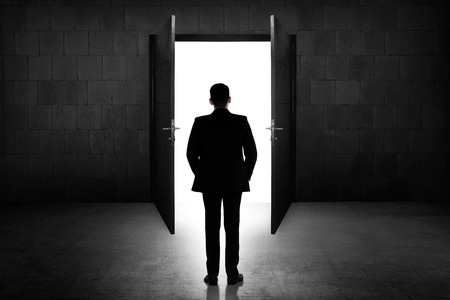 open concept: Business man going to the open door. Career path conceptual Stock Photo
