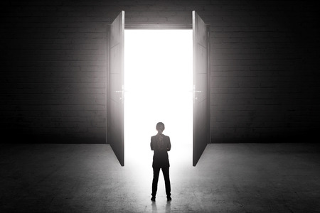 career path: Business woman going to the open door. Career path conceptual Stock Photo
