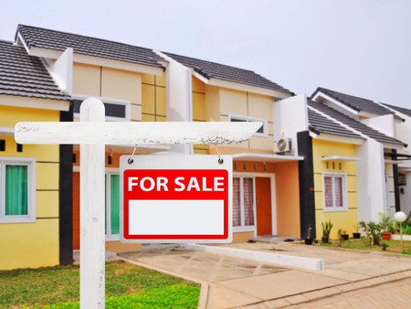 buying a house: House for sale board with house background. You can put your number on the board Stock Photo