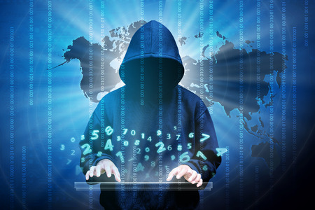 Computer hacker silhouette of hooded man with binary data and network security terms Stock Photo