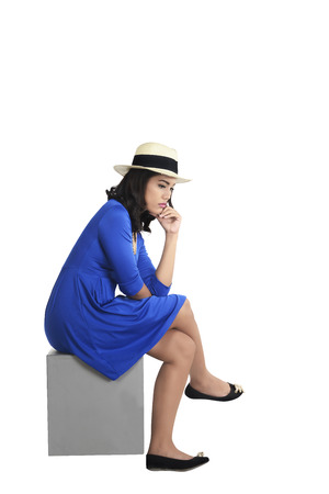 woman wearing hat: Asian woman wearing hat sitting and look sad