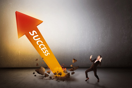 Asian business woman surprise looking arrow of success out from bottom. Business success conceptual Stock Photo