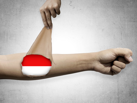 patriot: Man open his skin and show Indonesian flag inside. Patriot conceptual Stock Photo