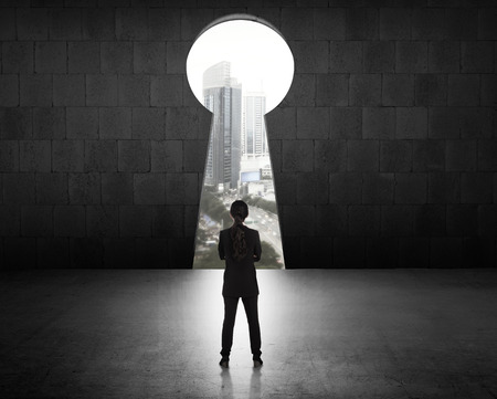 key hole: Concept of success business woman looking through key hole