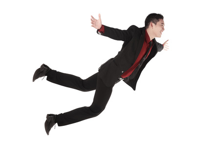 Falling and screaming business man in formal wear over white background