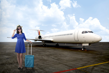 Traveler woman walk with suitcase into private jet airplane. Travel concept