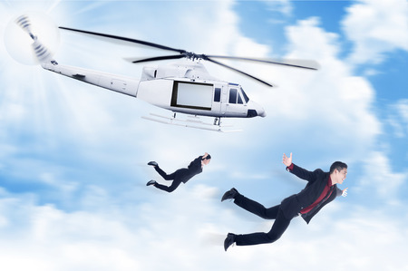 heli: Business man and woman jump from helicopter. Business challenge concept