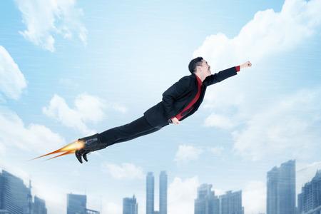 donna volante: Business donna volare con razzi sul suo concetto di promozione shoes.Job Archivio Fotografico