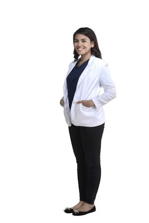 fullbody: Asian female doctor standing fullbody isolated over white background