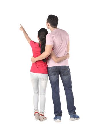 Jong Aziatisch paar wijzen iets geïsoleerd op witte achtergrond Stockfoto - 44419668