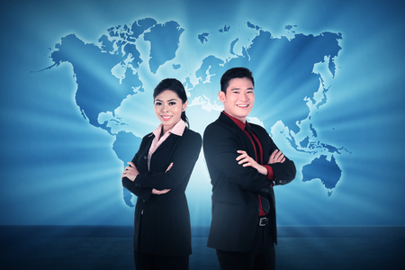 world of work: Business man and woman over world map background. Business team conceptual