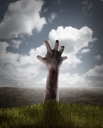 creepy hand: Zombie hand coming out of his grave. Halloween concept Stock Photo