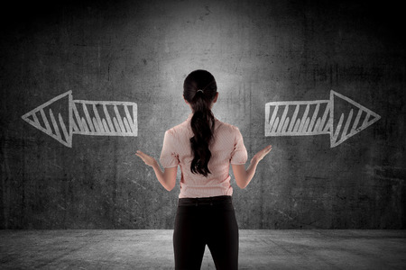 Business woman has to choose between two way. Business option conceptual Фото со стока