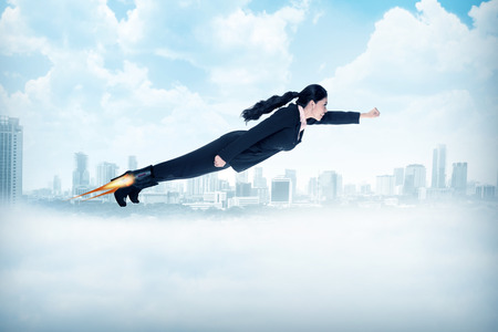 freedom concept: Business woman flying with rocket on her shoes. Business career concept Stock Photo