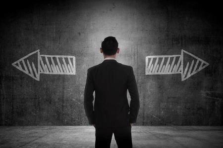 Business man has to choose between two way. Business option conceptual