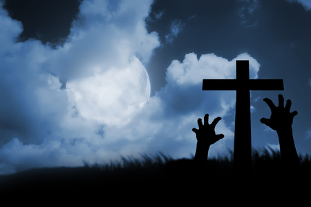 rising dead: Zombie hand coming out of his grave. Halloween concept Stock Photo