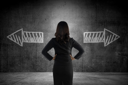 2 way: Business woman has to choose between two way. Business option conceptual Stock Photo
