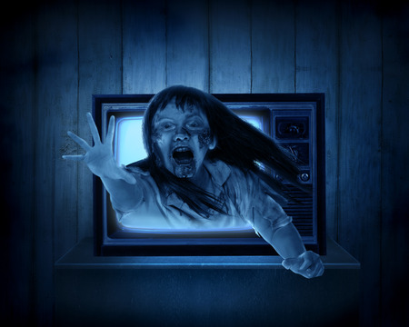 vintage television: Scary ghost out from old television. Halloween concept