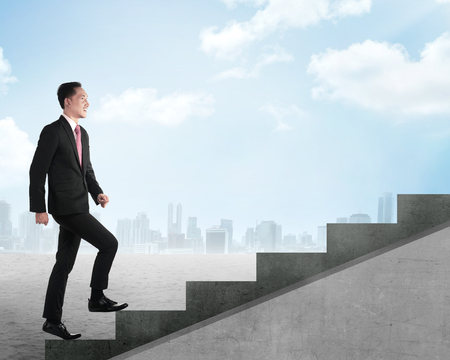 upstairs: Confident business person walking upstairs. Business career concept