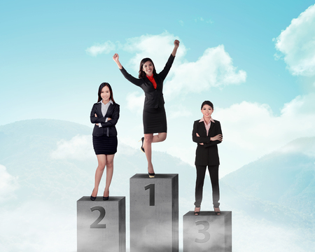 podium: Business person standing on the podium. Business reward concept