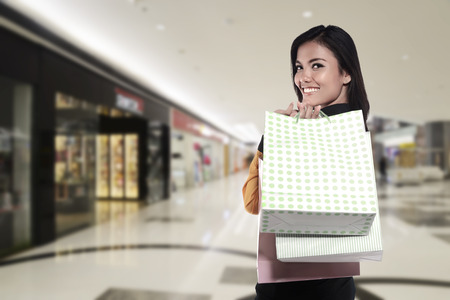 one female: Asian woman holding shopping bag. Shopping sale concept