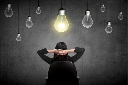 imagine a science: Business person having a bright idea light bulb concept. Business creative conceptual