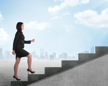 indonesian woman: Confident business person walking upstairs. Business career concept