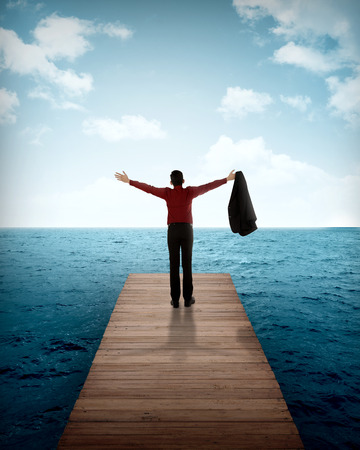 person standing: Business person standing on the wooden pier. Business success concept
