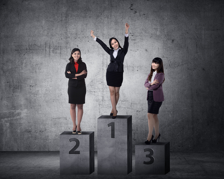 person standing: Business person standing on the podium. Business reward concept