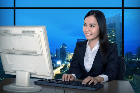 overtime: Business woman working late. Overtime concept
