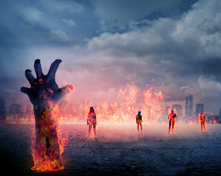 rising dead: Zombie hand with fire rising from the ground. Halloween concept Stock Photo