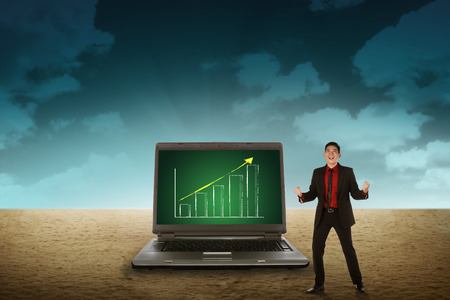 person looking: Business person looking giant laptop on the desert. Wireless concept