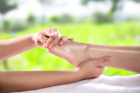 feet relaxing: Enjoying and relaxing healthy foot massage close up