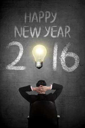 person looking: Business person looking Happy New Year 2016 writing. Business success concept Stock Photo
