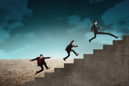 fast: Business team race to the top stair. Business achievement concept