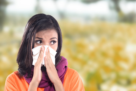 sniffles: Young sick woman having cold with bedroom background Stock Photo