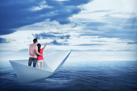 water concept: Asian couple on the paper boat, sailing on the sea